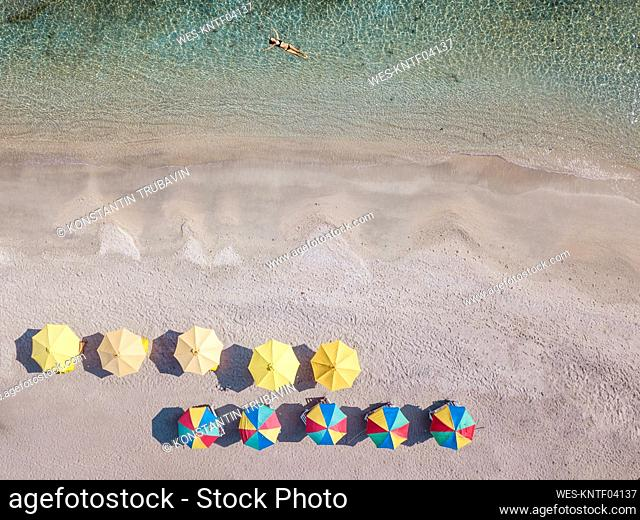 Indonesia, Bali, Aerial view of young woman relaxing in coastal water