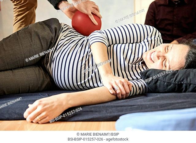 Reportage on a midwife in Lyon, France during a eutony session. Eutony is a method which helps develop body-consciousness