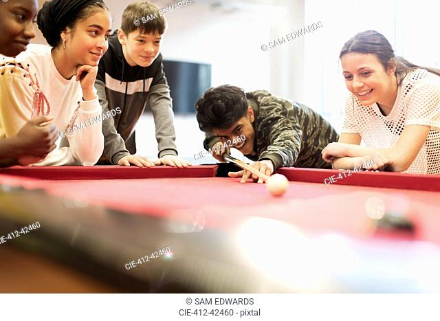Teenagers playing pool