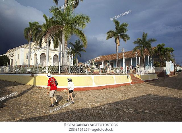 Tourists at the park in Plaza Mayor-Main Square at the afternoon light in the town center, Trinidad, Sancti Spiritus Province, Cuba, Central America