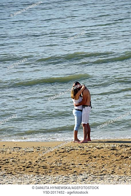 young couple kissing at the seaside, sandy beach, Atlantic Ocean, Cabourg, Calvados, Basse Normandie, Normandy, France