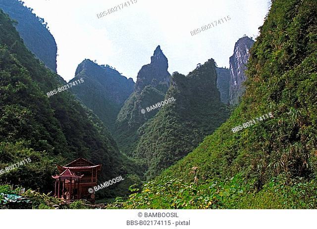 Miao minority housing amid mountains, in Dehang, Jishou City, Xiangxi Prefecture, Hunan Province, People's Republic of China
