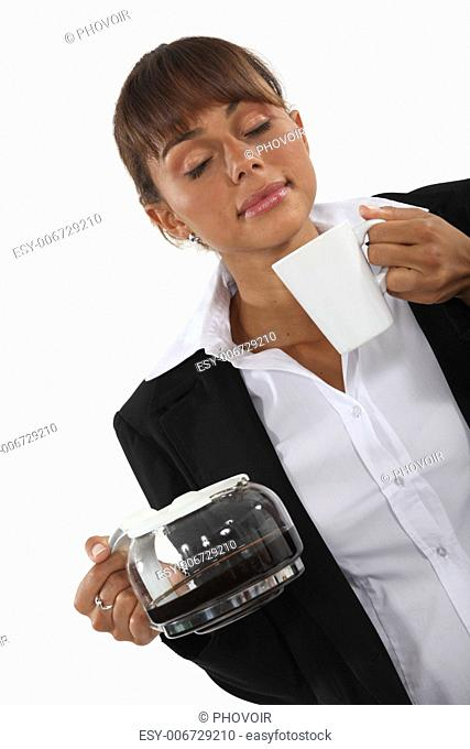woman smelling the morning coffee