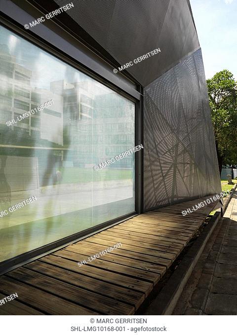 Wooden walkway outside modern building