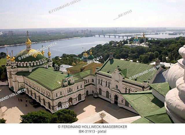 Ukraine Kiev the monastery of cave Kyjevo Pecers'ka Lavra view to the dome of Refectoriums church with small golden towers green river side view to the city at...