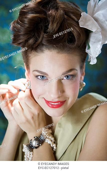 Portrait of happy stylish woman wearing evening wear, looking at camera