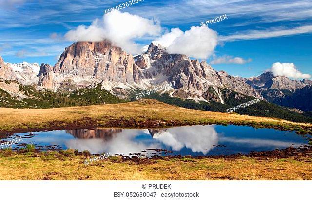 View from passo Giau, Tofana or Le Tofane Gruppe, mountain mirroring in lake, Dolomites, Italy