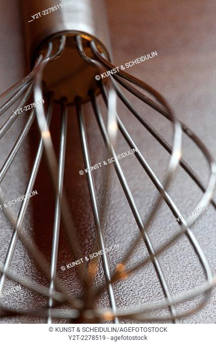 Close up of a metal whisk