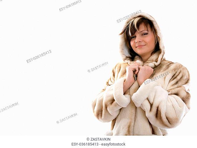 Portrait of frozen girl in fur coat