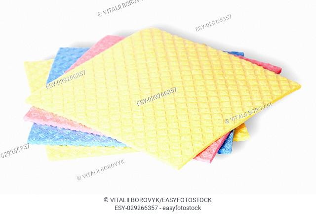 Are scattered colorful sponges for dishwashing isolated on white background