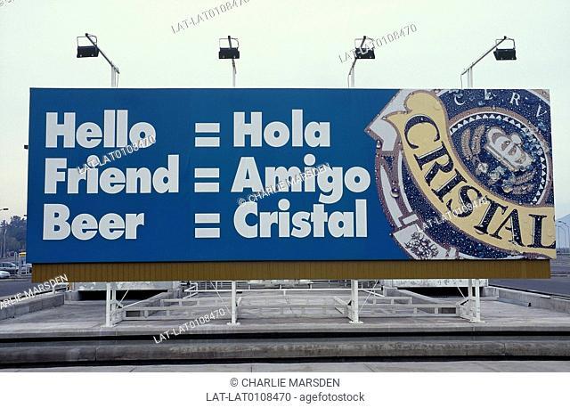 Billboard. Bi-lingual sign for Cristal beer at airport. Lights