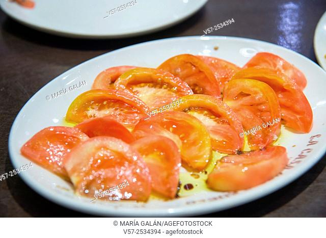 Salad with tomato and olive oil. Close view