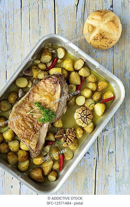 Roast lamb with potatoes and garlic