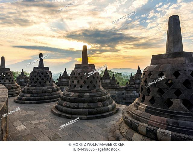 Borobudur Temple at sunrise, stupas, cloudy sky, Borobudur, Yogyakarta, Java, Indonesia