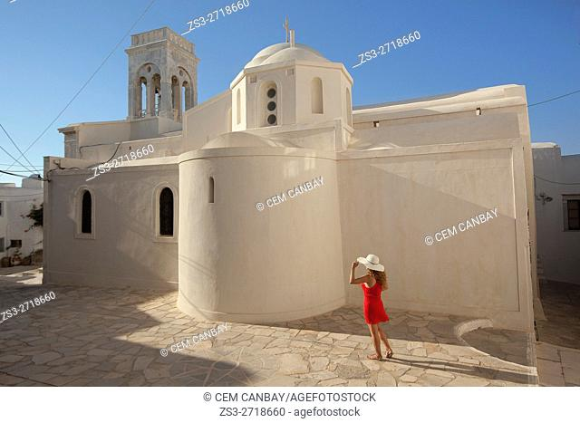 Woman in front of the Catholic church in the town center Chora, Naxos, Cyclades Islands, Greek Islands, Greece, Europe