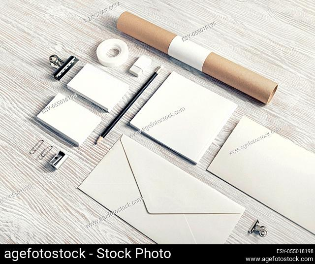 Photo of blank stationery set on light wooden background. Corporate identity mock up for placing your design