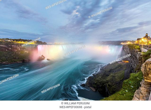 Canada, Ontario, Niagara Falls dramatic long exposure view at dusk