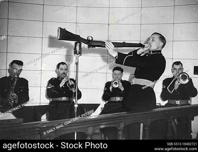 Blowing His Top -- Making a desperate attempt to get that rifle clean? No. Bandsman John Pelling, of the Royal Military Academy Band at Sandhurst