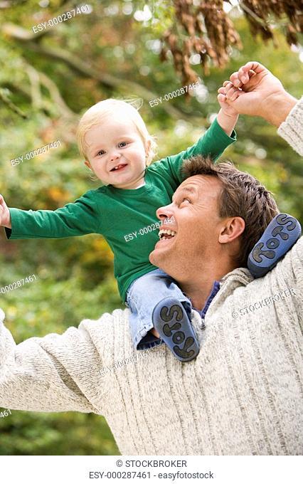 Father giving baby son piggyback