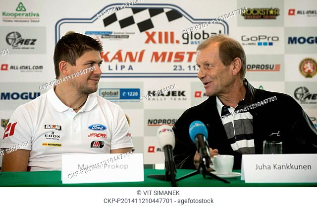 The four-time world rally champion Juha Kankkunen (right) and Czech rally driver Martin Prokop speak during press conference in Prague
