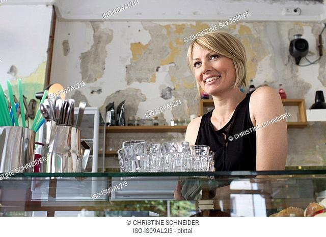 Mid adult woman working in cafe