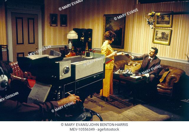 Filming of Upstairs Downstairs -- scene in a reception room, with Hannah Gordon as Virginia Bellamy and Simon Williams as James Bellamy
