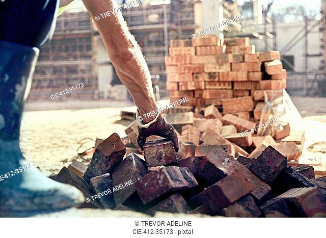 Construction worker bricklaying at construction site