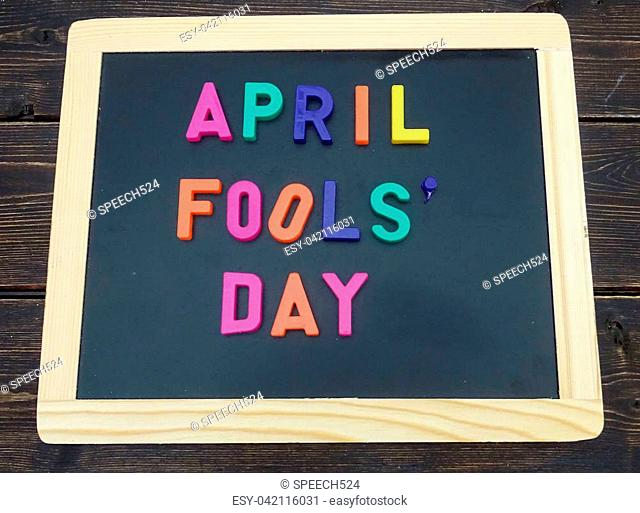 April fools day sign on a chalkboard with magnetic letters