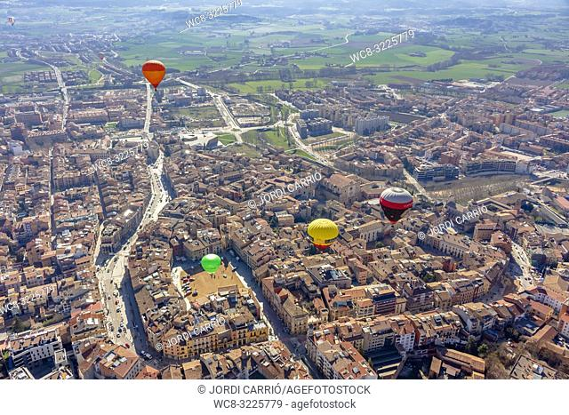 VIC, CATALONIA, SPAIN - MARCH 2018: Aerial view of the city of Vic where the participants of the XXXV edition of the International Mercat Ram Balloon Trophy...