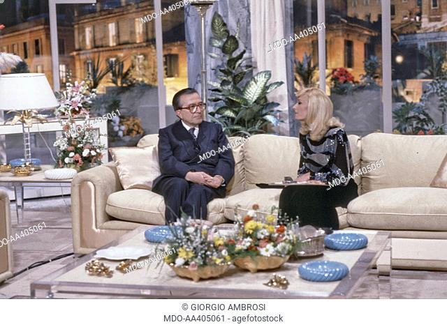 Raffaella Carrà with Giulio Andreotti in Buonasera Raffaella. Italian TV host, actress, singer and showgirl Raffaella Carrà (Raffaella Maria Roberta Pelloni)...