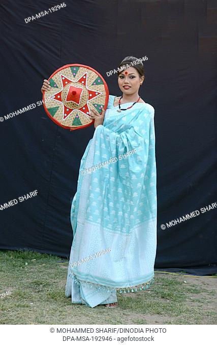 Woman Holding Jaapi Assam India Asia Mr#786