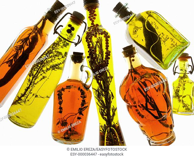 Oil olive and vinegars with aromatic herbs