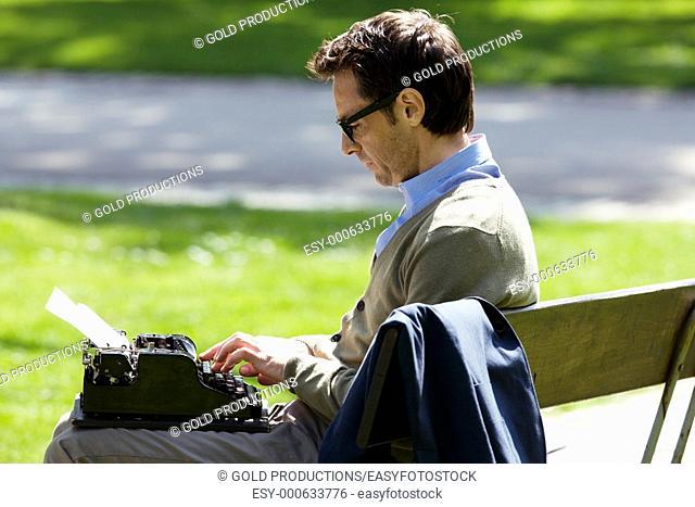 man writing on a vintage typewriter