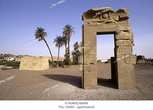 Old ruins of building on arid landscape, Aswan, Egypt