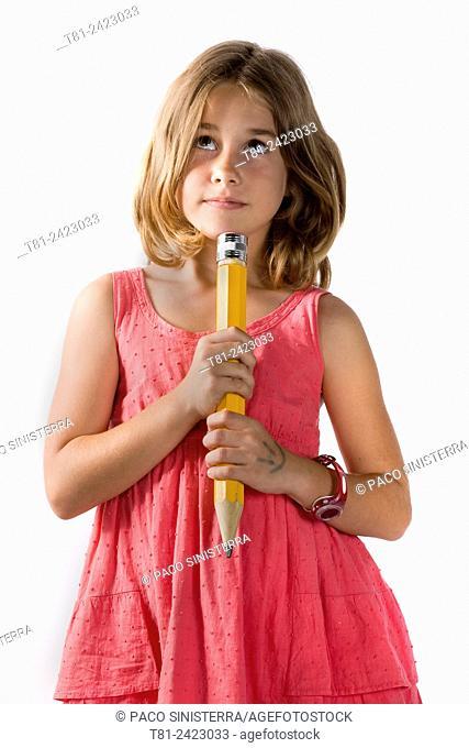 girl thinking with pencil, studio Valencia, Spain