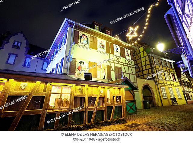 Hansi drawings Christmas decoration by night at the Little Venice. Colmar. Wine route. Haut-Rhin. Alsace. France