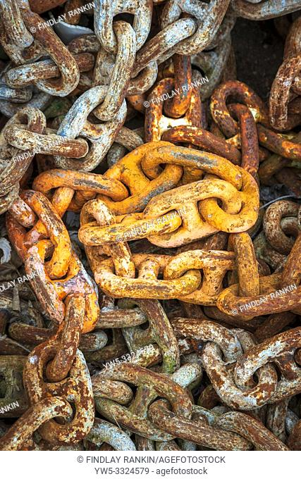 Old rusty industrial heavy duty chains lying at a workplace, Ayrshire, Scotland, UK