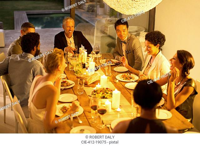 Friends eating together at dinner party