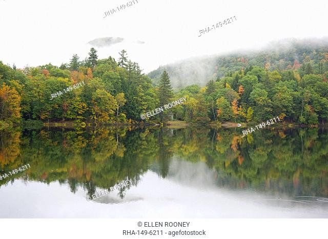 Mist rising over hills and autumn foliage around the Woodward Reservoir in central Vermont, New England, United States of America, North America