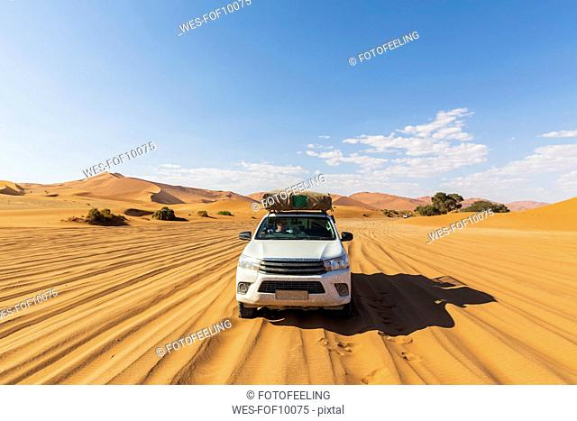 Africa, Namibia, Namib desert, Naukluft National Park, off-road vehicle on sand track