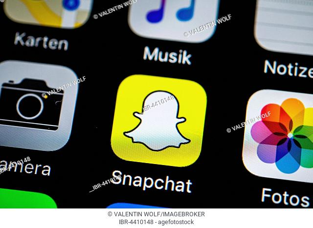 Smartphone screen display with Photos and Snapchat app icons in detail