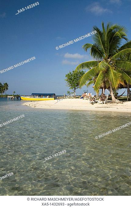 Small beach with boat at the dock, Yandup Island, San Blas Islands also called Kuna Yala Islands, Panama