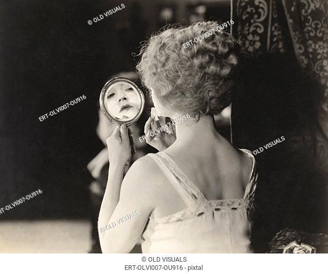 Removing her makeup (OLVI007-OU916-F)