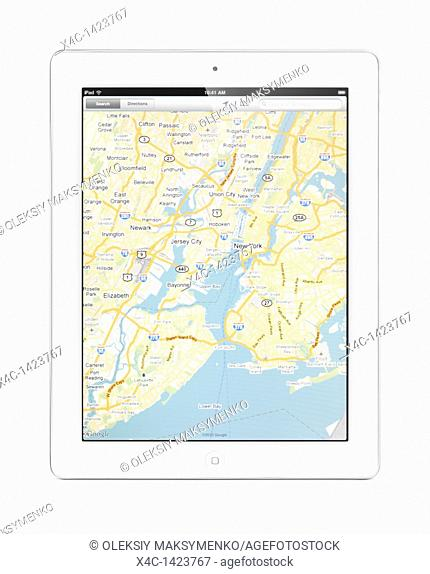 Apple iPad 2 tablet computer with a map of New York by Google Maps on its display  Isolated with clipping path on white background