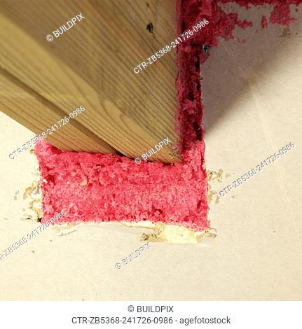 Insulating foam prevents draughts in roof beam