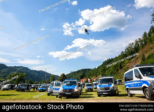 dpatop - 13 July 2020, Baden-Wuerttemberg, Oppenau: A police helicopter flies over a sports field near the community of Oppenau