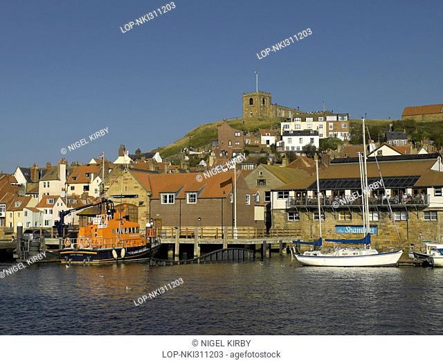 England, North Yorkshire, Whitby. RNLI lifeboat George and Mary Webb moored below St Marys Church at Whitby Lifeboat Station