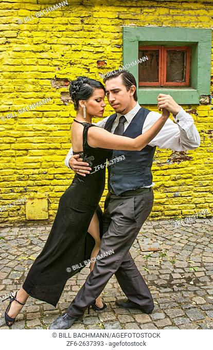 Buenos Aires Argentina La Boca tango dance with couple on street with colors worn walls with passion