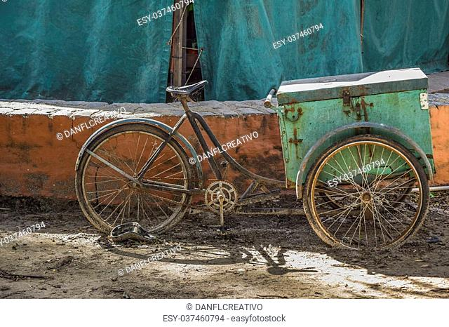 Side view of abandoned old style bicycle in a sunny day at park in La Plata city, Buenos Aires