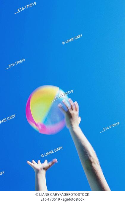 Child catching a beach ball